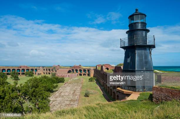 usa, florida, florida keys, dry tortugas national park, lighthouse in fort jefferson - dry tortugas stock pictures, royalty-free photos & images