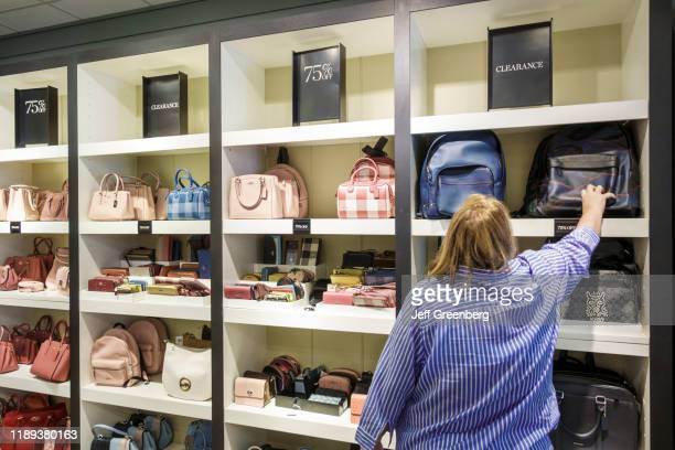 Florida, Fort Myers, Sanibel Outlets Mall, woman shopping in Coach handbag store.