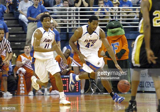 Florida forward Al Harford brings the ball upcourt as guard Lee Humphrey follows against Alabama State at the Stephen C O'Conner Center November 28...