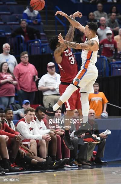 Florida forward Kevarrius Hayes blocks a shot attempt bye Arkansas guard Anton Beard during a Southeastern Conference Basketball Tournament game...