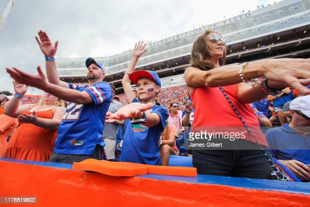 Florida Gator fans cheer during the fourth quarter of a game against the Towson Tigers at Ben Hill Griffin Stadium on September 28 2019 in...
