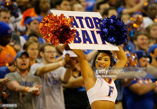 Florida Gators cheerleader performs during the game against the Arkansas Little Rock Trojans at Stephen C O'Connell Center on November 16 2013 in...
