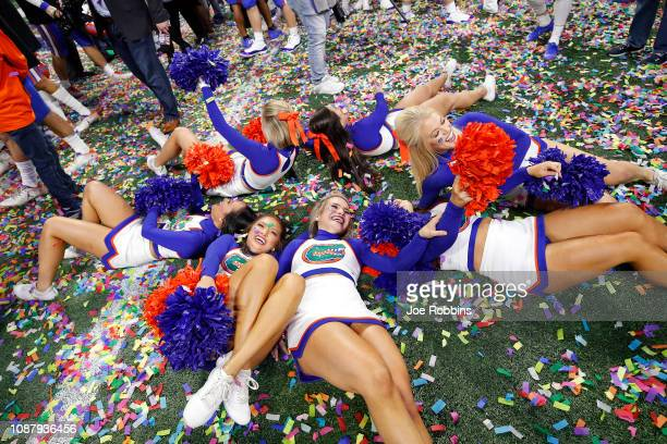 Florida Gators cheerleaders celebrate after their teams win over the Michigan Wolverines during the ChickfilA Peach Bowl at MercedesBenz Stadium on...