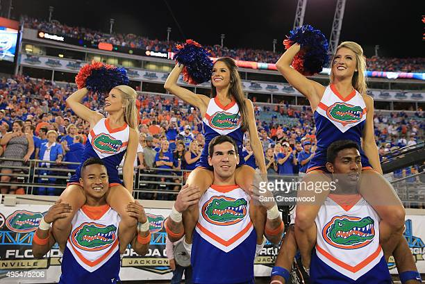 Florida Gators cheerleaders perform during the game against the Georgia Bulldogs at EverBank Field on October 31 2015 in Jacksonville Florida