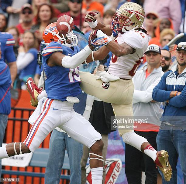 Florida Gators defensive back Loucheiz Purifoy intercepts a pass Forida State Seminoles wide receiver Rashad Greene at Ben Hill Griffin Stadium in...