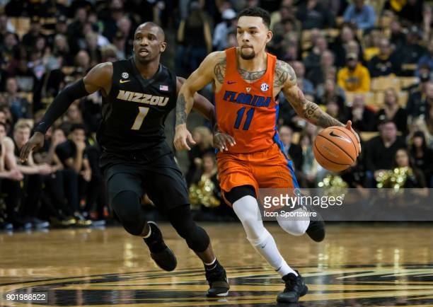 Florida Gators guard Chris Chiozza brings the ball up court past Missouri Tigers guard Terrence Phillips during the SEC regular season game between...
