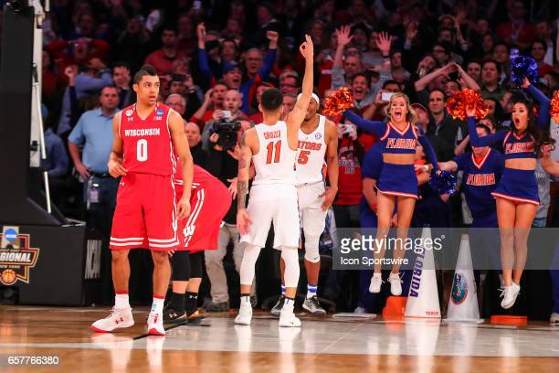 Florida Gators guard Chris Chiozza celebrates after making the game winning three point shot during overtime of the 2017 NCAA Men's Basketball...
