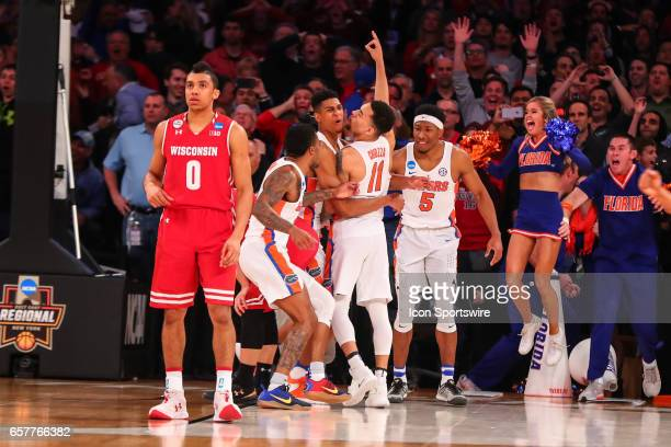 Florida Gators guard Chris Chiozza celebrates with teammates after making the game winning three point shot during overtime of the 2017 NCAA Men's...