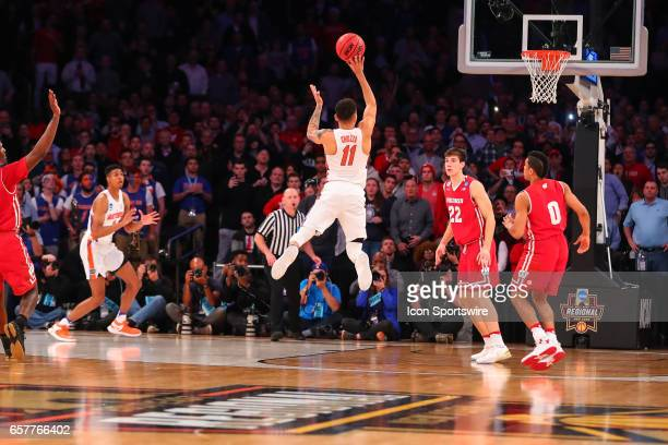 Florida Gators guard Chris Chiozza shoots the game winning three point shot during overtime of the 2017 NCAA Men's Basketball Tournament East...