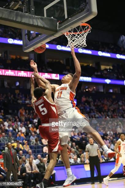 Florida Gators guard Keyontae Johnson fights for a layup with Arkansas Razorbacks guard Jalen Harris during a Southeastern Conference Tournament game...
