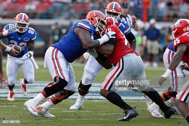 Florida Gators offensive lineman Jawaan Taylor blocks Georgia Bulldogs defensive tackle Trenton Thompson during the NCAA football game between the...