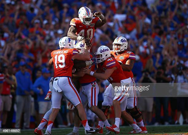 Florida Gators players celebrate with Austin Hardin after he made the gamewinning field goal during the fourth quarter of the game against the...