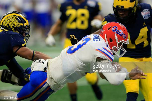 Florida Gators quarterback Feleipe Franks dives in the end zone for a touchdown during the Peach Bowl between the Florida Gators and the Michigan...