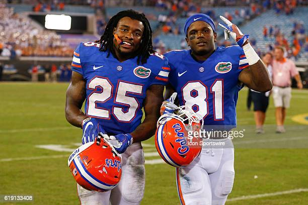 Florida Gators running back Jordan Scarlett and Florida Gators wide receiver Antonio Callaway walk off the field after the NCAA football game between...