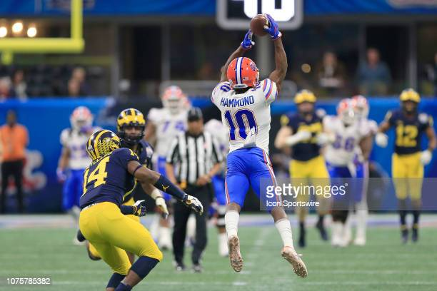 Florida Gators wide receiver Josh Hammond leaps to catch a pass during the Peach Bowl between the Florida Gators and the Michigan Wolverines on...