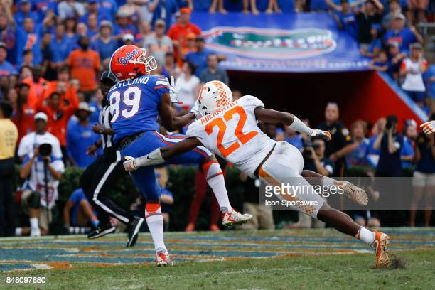 Florida Gators wide receiver Tyrie Cleveland catches a pass well being covered by Tennessee Volunteers defensive back Micah Abernathy as time runs...