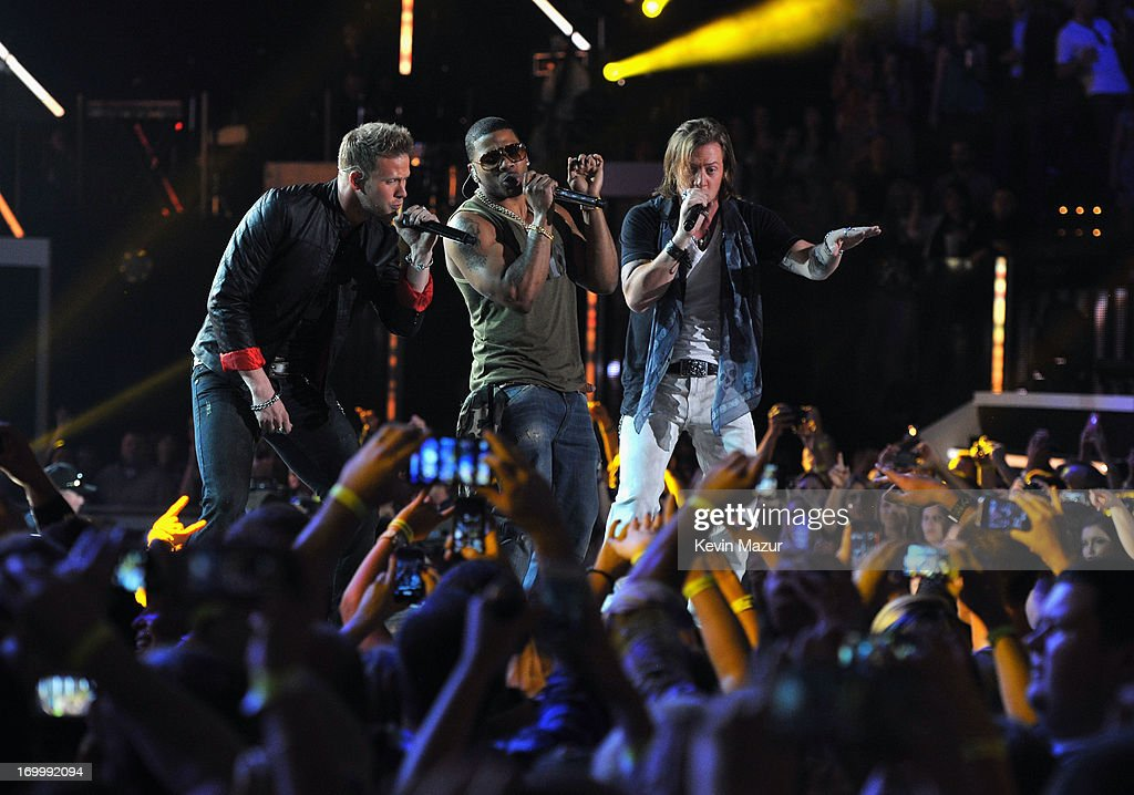 Florida Georgia Line and Nelly perform during the 2013 CMT Music awards at the Bridgestone Arena on June 5, 2013 in Nashville, Tennessee.