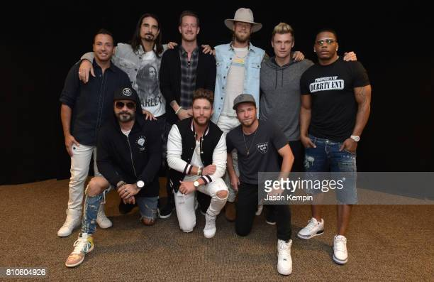 Florida Georgia Line Backstreet Boys Chris Lane and Nelly pose for a snapshot backstage at the Florida Georgia Line's soldout show at Fenway Park on...