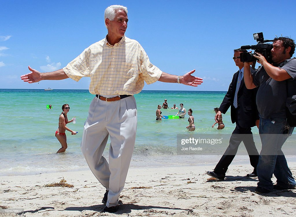 Florida Gov Charlie Crist Is Followed By The Media As He Claims That Miami Beach