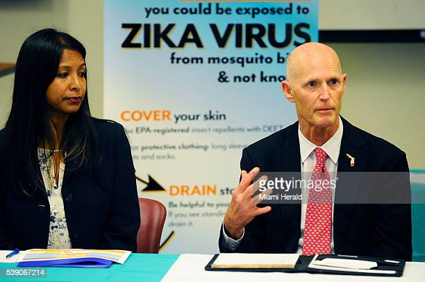 Florida Gov Rick Scott right along with state surgeon general Celeste Philip left speaks to local officials about ways to combat the spread of the...