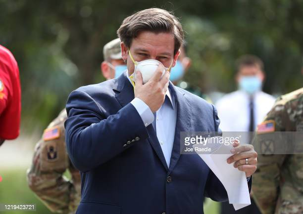 Florida Gov. Ron DeSantis adjusts his mask after giving updates on the state's continued response to the coronavirus pandemic during a press...