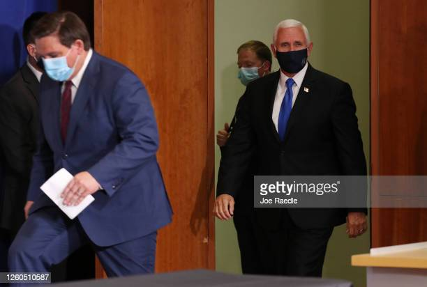 Florida Gov Ron DeSantis and Vice President Mike Pence arrive for a press conference at the the University of Miami Miller School of Medicine on July...