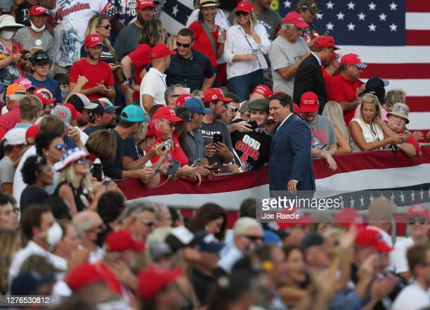Florida Gov Ron DeSantis greets people before the arrival of President Donald Trump for his 'The Great American Comeback Rally' at Cecil Airport on...