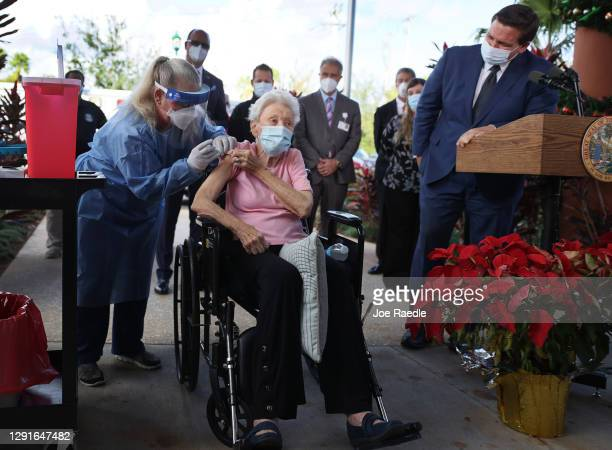 Florida Gov. Ron DeSantis looks on as Vera Leip receives a Pfizer-BioNtech COVID-19 vaccine from Christine Philips, RN Florida Department of Health...