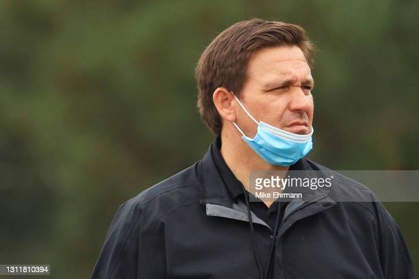 Florida Gov. Ron DeSantis looks on during the third round of the Masters at Augusta National Golf Club on April 10, 2021 in Augusta, Georgia.