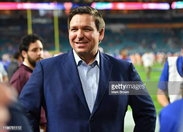 Florida Gov Ron DeSantis looks ons during warms up prior to the Capital One Orange Bowl between the Florida Gators and the Virginia Cavaliers at Hard...
