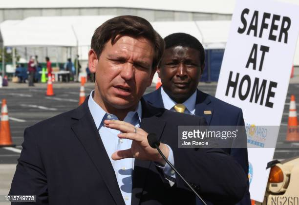 Florida Gov Ron DeSantis speaks during a news conference in the Hard Rock Stadium parking lot on March 30 2020 in Miami Gardens Florida The news...