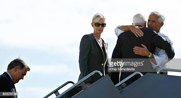 Florida Governor Charlie Crist embraces Republican presidential nominee Sen John McCain as he and his wife Cindy McCain and Sen Mel Martinez board...