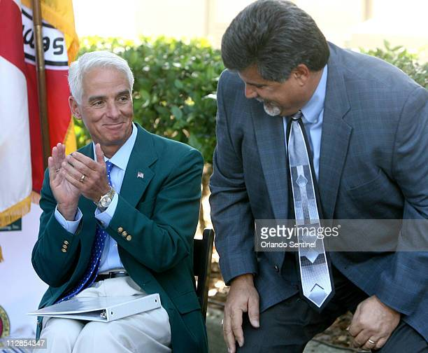 Florida Governor Charlie Crist left applauds as Seminole Hard Rock Casino president John Fontana is introduced during a ceremony where the Seminole...