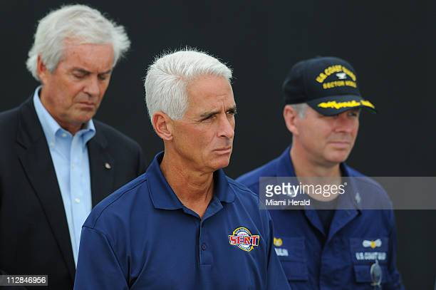 Florida Governor Charlie Crist looks on as Vice President Joe Biden addresses members of the media at a US Naval Air Station in Pensacola Florida on...