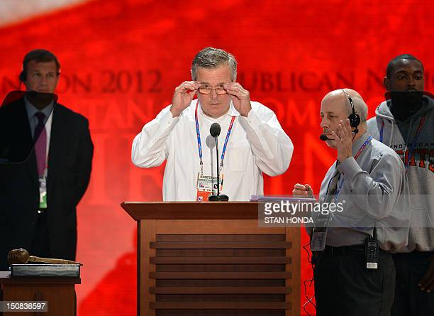 Florida Governor Jeb Bush adjusts his glasses during a sound check at the Tampa Bay Times Forum in Tampa Florida on August 27 2012 Due to tropical...