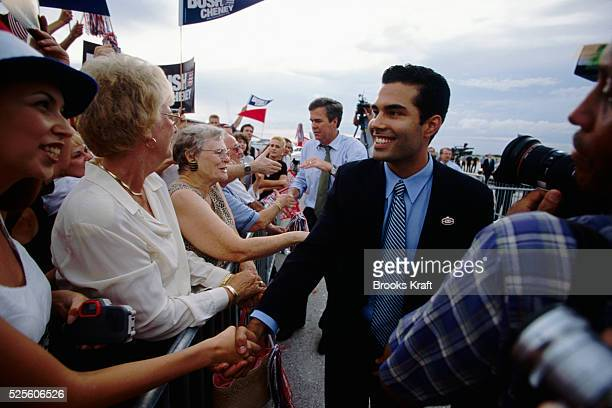 Florida Governor Jeb Bush and son George Prescott shake hands on while campaigning They are campaigning in Sarasota for Jeb's brother George W Bush...