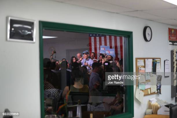 Florida Governor Rick Scott addresses supporters as he holds a Senate campaign rally at the Interstate Beverage Corp on April 10 2018 in Hialeah...