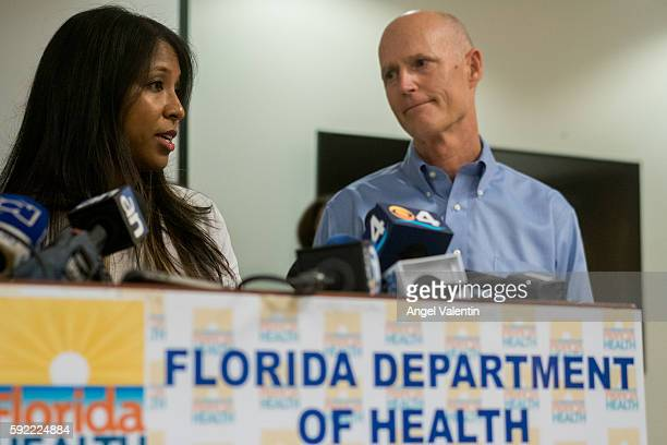 Florida Governor Rick Scott and Florida Surgeon General Dr Celeste Philip address the media gathered at the MiamiDade County Department of Health as...