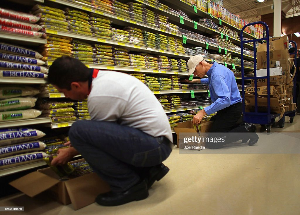 Florida Governor Rick Scott (R) and Jorge Rodriguez stock the shelves with Goya products at the Sedano's Supermarket on January 11, 2013 in Miami, Florida. Governor Scott spent his 15th 'Let's Get to Work Day' highlighting the importance of building up manufacturing jobs.