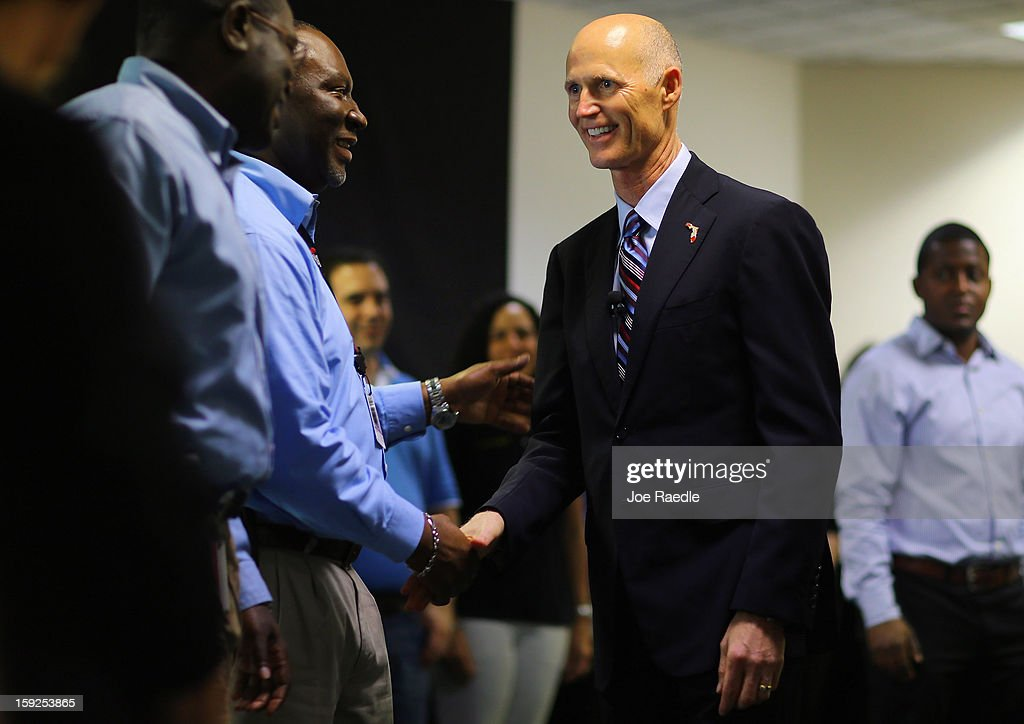 Florida Governor Rick Scott greets workers after he toured the manufacturing facility at Beckman Coulter, a biomedical laboratory instruments manufacturer, on January 10, 2013 in Miami, Florida. The governor continues his push to create new business opportunities in the state and earlier in the week announced a plan to call on the State Legislature to eliminate the sales tax on equipment purchased by companies for their production plants.