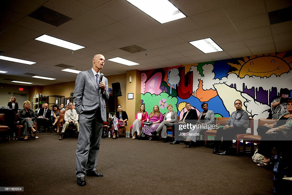 Florida Governor Rick Scott speaks during a town hall meeting with the Agency for Persons with Disabilities (APD) at the Spelios Center, one of Sunrise Groups adult day training centers, to discuss issues impacting the greater disabilities community on September 19, 2013 in Miami, Florida. The Florida Governor leads the state that has refused to set up its own health care exchange in preparation for the Affordable Care Act, which is set to begin enrollment on October 1. Republican leaders in Florida have also highlighted concerns about the navigators, federally funded workers who will help enroll people in health plans.