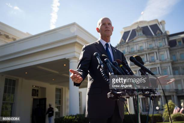Florida Governor Rick Scott speaks to reporters following his meeting with President Donald Trump at the White House September 29 2017 in Washington...