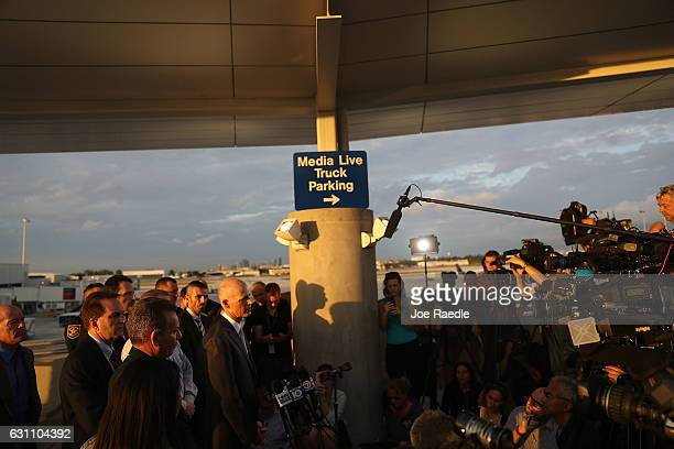 Florida Governor Rick Scott speaks to the media as first responders secure the area outside the Fort LauderdaleHollywood International airport after...