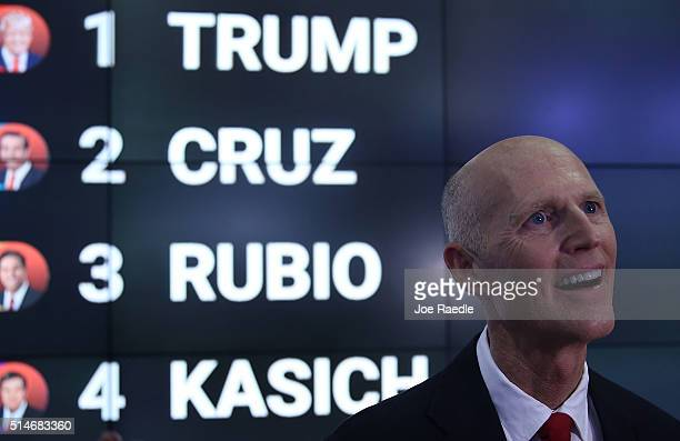 Florida Governor Rick Scott speaks with the media before the Republican presidential debate on the campus of the University of Miami on March 10 2016...