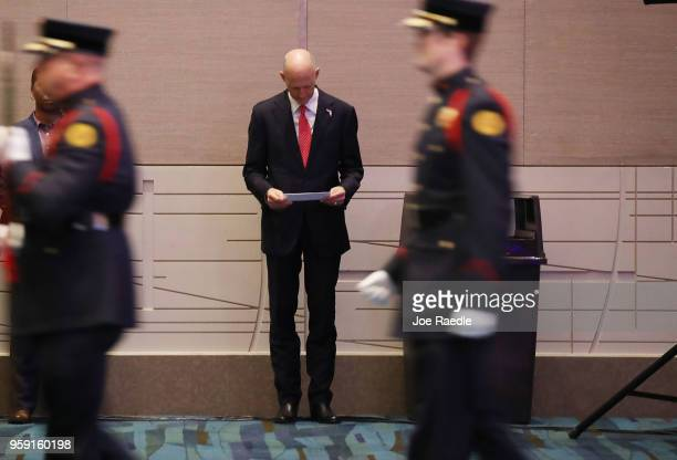 Florida Governor Rick Scott waits to be introduced to speak during the Governor's Hurricane Conference at Palm Beach County Convention Center on May...