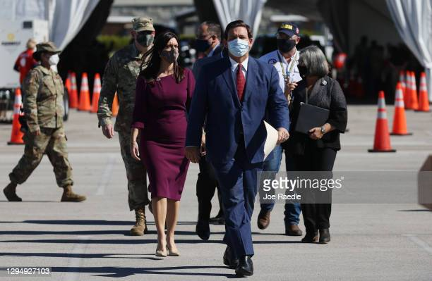 Florida Governor Ron DeSantis arrives for a press conference about the opening of a COVID-19 vaccination site at the Hard Rock Stadium on January 06,...