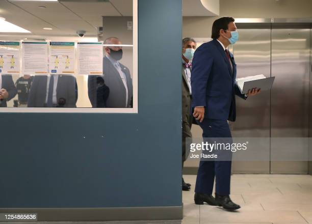 Florida Governor Ron DeSantis arrives to speak during a press conference about the coronavirus held at the Pan American Hospital on July 07, 2020 in...