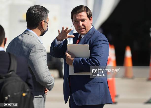 Florida Governor Ron DeSantis leaves after holding a press conference about the opening of a COVID-19 vaccination site at the Hard Rock Stadium on...