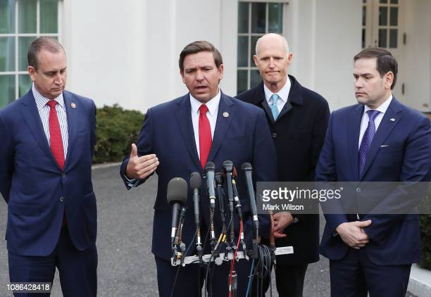 Florida Governor Ron DeSantis speaks to the media while flanked by Rep Mario DiazBalart Sen Rick Scott and Sen Marco Rubio after a meeting with...