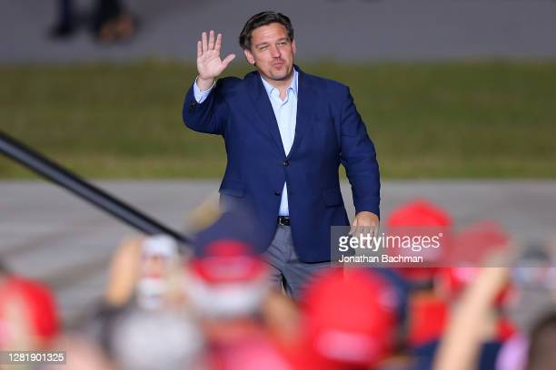 Florida Governor Ron DeSantis waves to supporters during a rally for President Donald Trump on October 23, 2020 in Pensacola, Florida. With less than...